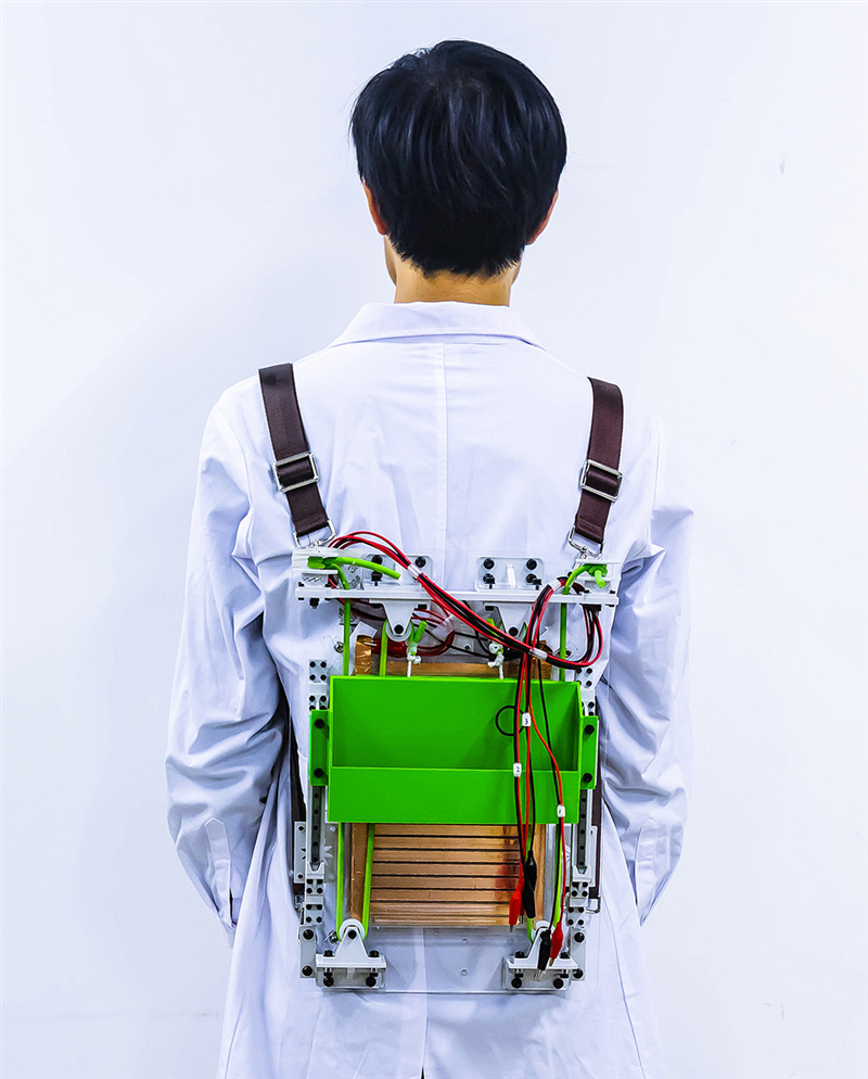 A prototype backpack harvests energy from walking to power small electronics, and it makes loads feel lighter. Credit: Adapted from ACS Nano 2021, DOI: 10.1021/acsnano.0c07498