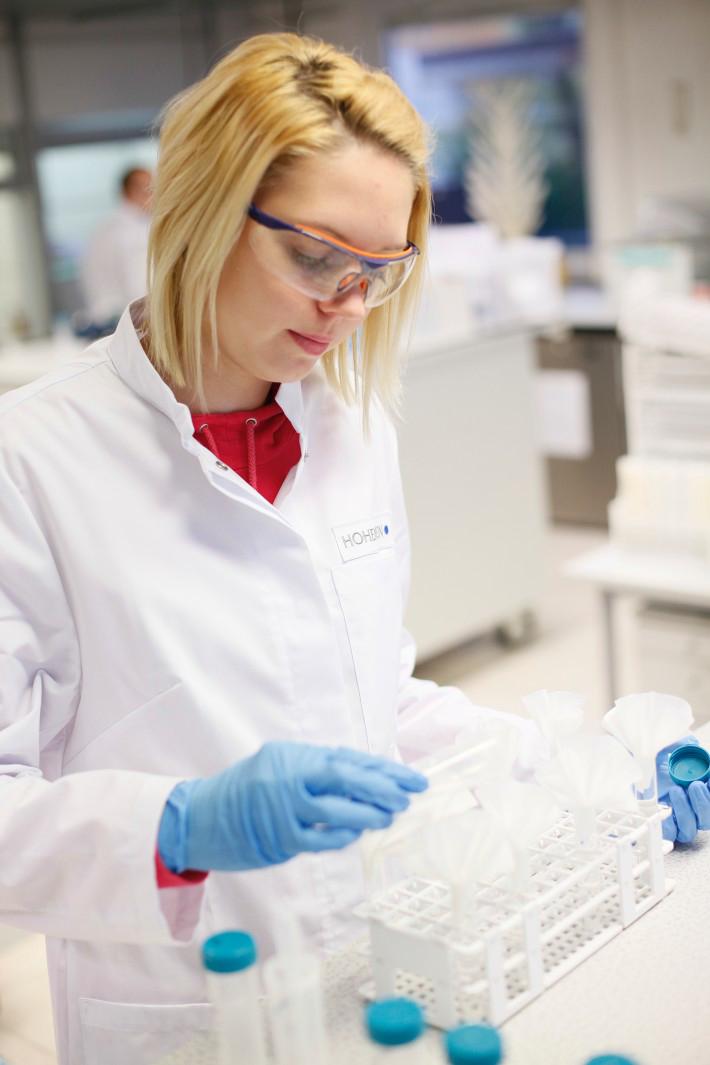 Qualified staff prepare the test specimens examination
